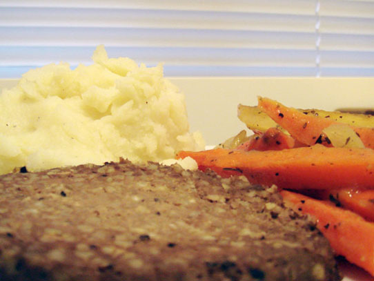 Leftover haggis with mashed potatoes and roast carrots